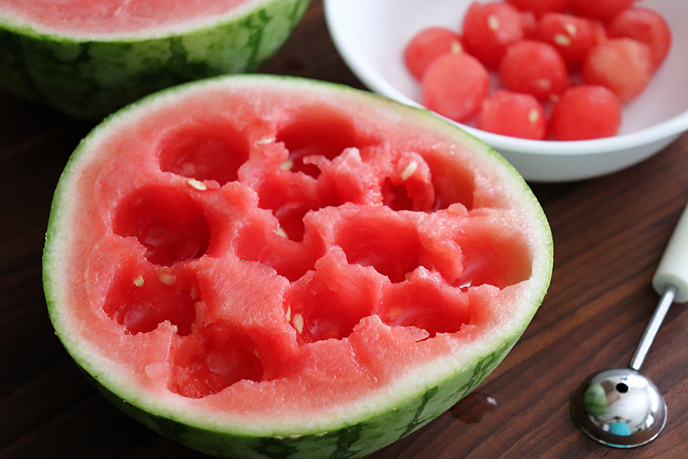 Scooping the watermelon into balls